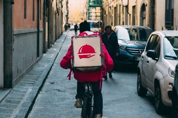 Pizza Delivery and Pickup Services on a Bike